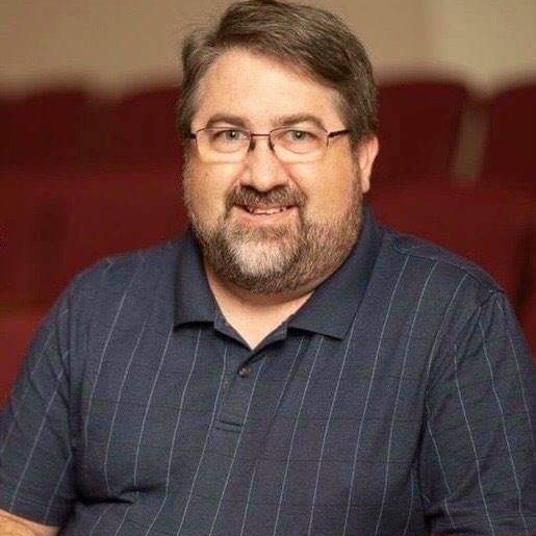 John M. Womeldorff (He/Him) head shot
